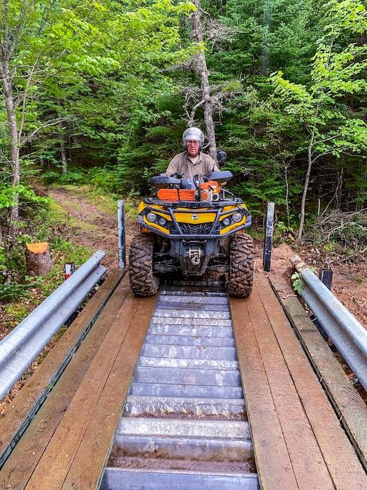 An ATVer crosses Chapel Road bridge in Huntington, N.S. CONTRIBUTED