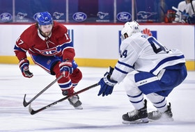 Josh Anderson of the Montreal Canadiens, left, and Morgan Rielly of the Toronto Maple Leafs skate after the puck during the third period at the Bell Centre on May 3, 2021 in Montreal.