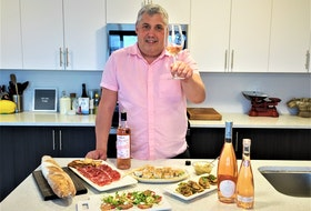 In a Jiffy host Mark DeWolf offers a toast with a glass of rose wine. Photo: Julia Webb