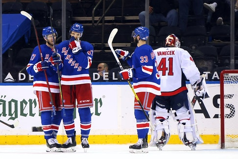 Morgan Barron of the New York Rangers, centre, celebrates his first NHL goal against the Washington Capitals at Madison Square Garden on Wednesday.
