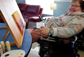 Nancy Marshall, a resident of Glen Haven Manor, is pictured creating art at her home which she says are part of  a multi-layered approach of techniques, supports and activities she engages in for her mental health well-being.