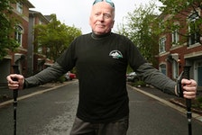Michael Baine poses for photo in front of his house in Ottawa Wednesday. Michael has stage four prostate cancer that has spread to his bones and hips. Despite that, he's walking 21 kilometres as part of Ottawa Race Weekend to raise money for The Ottawa Hospital Cancer Centre.