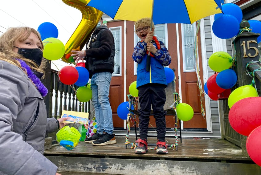 """Joshua Petrone was one ecstatic 7-year-old on May 4 as cars drove by honking, full of """"Happy Birthday"""" greetings. CARLA ALLEN • TRICOUNTY VANGUARD"""