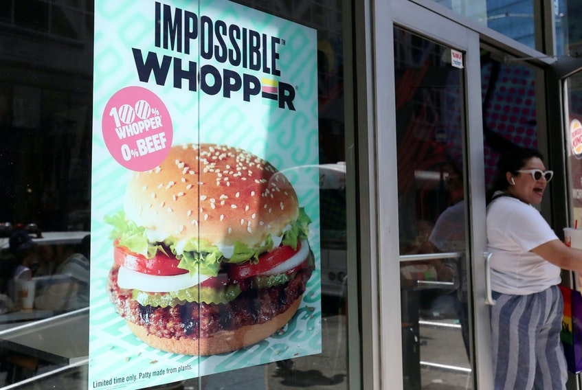 A sign advertises the soy-based Impossible Whopper at a Burger King in New York City. REUTERS/Shannon Stapleton/File Photo