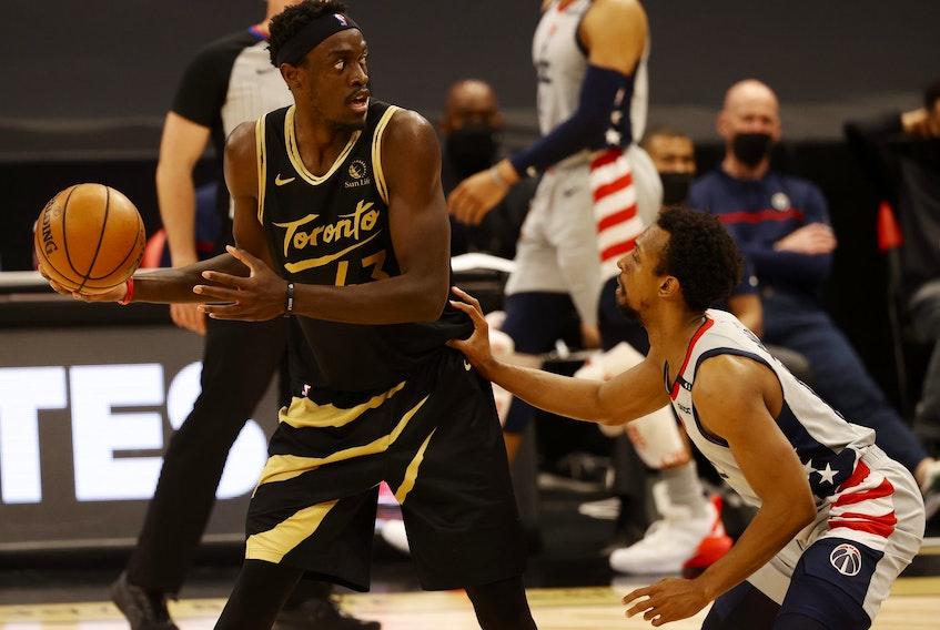 Toronto Raptors forward Pascal Siakam  drives to the basket as Washington Wizards guard Ish Smith defends on Thursday night.