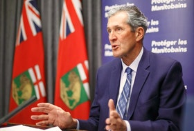 Premier Brian Pallister announces that his government is launching a new Manitoba Pandemic Sick Leave program that will provide direct financial assistance to help fill gaps between federal programming and current provincial employment standards for paid sick leave, during a press conference at the Manitoba Legislative building Friday morning. MIKE DEAL/POOL/WINNIPEG FREE PRESS