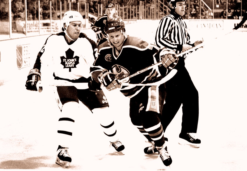 In this Oct. 22, 1991 file photo, St. John's Maple Leafs defenceman Guy Lehoux (left) holds back Cape Breton Oilers forward Dean Antos during an American Hockey League game at Memorial Stadium in St. John's. The linseman is Bernie Degrace. The Leafs won 5-1 in what was their third home game of their inaugural season. Lehoux, a rookie, played seven seasons in St. John's and was one of the team's most popular players during its 14 years in the AHL. — Telegram file photo/Keith Gosse