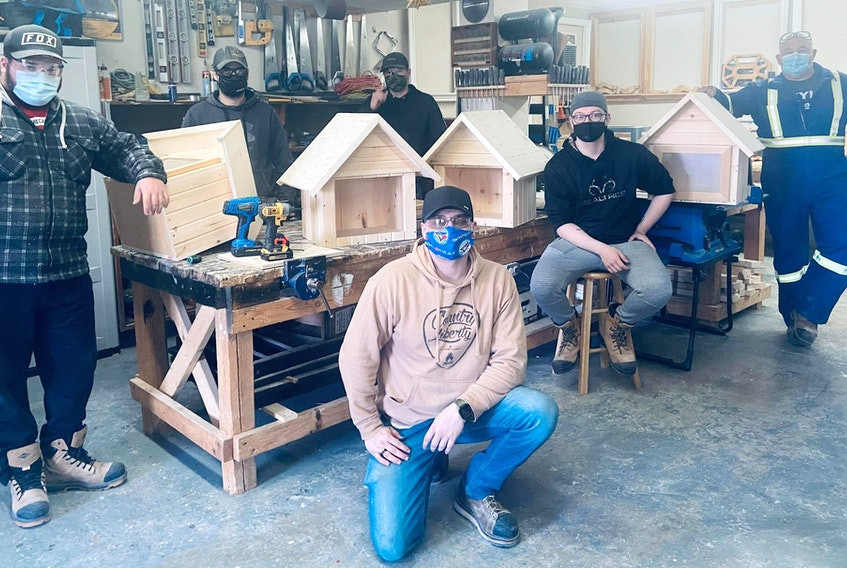 Keyin College carpentry instructor Jody Manning and students Brady Boland, Shane Baker, Damian Hanrahan, Dylan Marks and Jarrod Stapleton helped make Burin Peninsula Brighter Futures' book library project a reality.