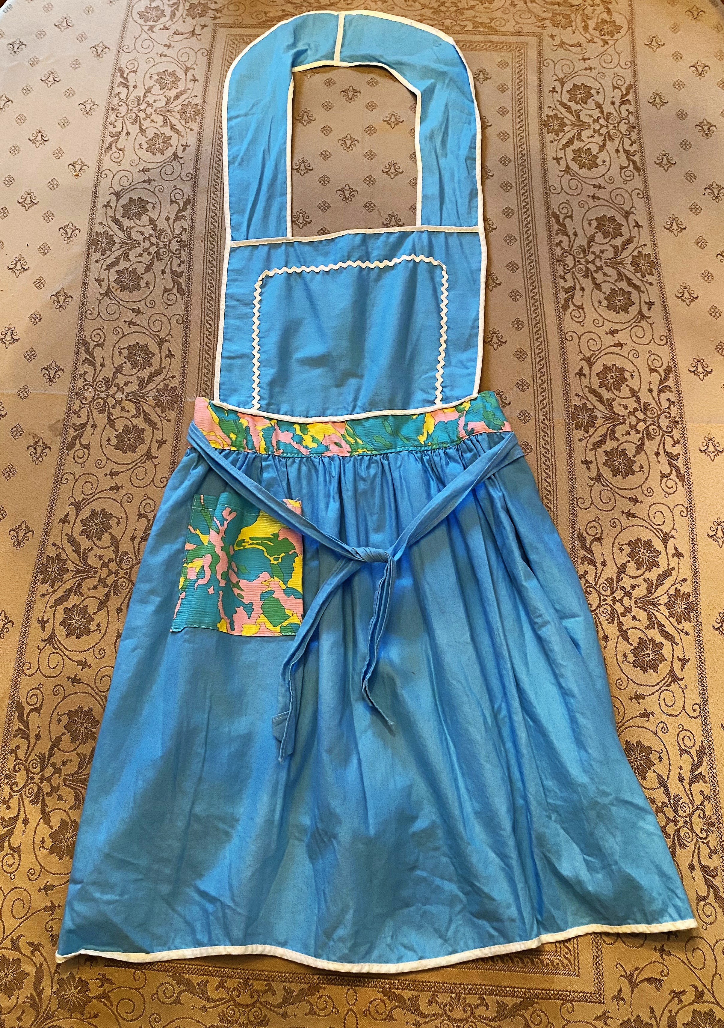 Over the years, I have collected many fancy aprons, but none quite as special as this one.  Mom tells me that I was only five years old when I helped her make it.  I stand a little taller when I wear my pretty apron. Happy Mother's Day, mom!