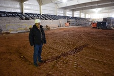 Cedric Gallant, project manager for the Tyne Valley Events Centre, stands on the ice surface with the seating area behind him. Gallant, who will also assume the manager's role for the 2021-22 season, said the goal is for the multi-purpose facility to have ice and be open in early October. The events centre will replace the Tyne Valley and Area Community Sports Centre, which was destroyed by fire on Dec. 29, 2019.