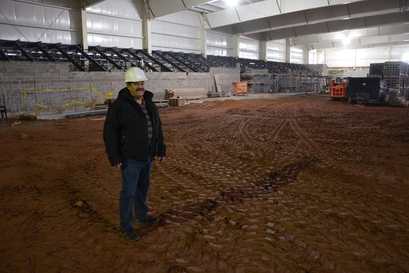 Cedric Gallant, project manager for the Tyne Valley Events Centre, stands on the ice surface with the seating area behind him. Gallant, who will also assume the manager's role for the 2021-22 season, said the goal is for the multi-purpose facility to have ice and be open in early October. The events centre will replace the Tyne Valley and Area Community Sports Centre, which was destroyed by fire on Dec. 29, 2019. - Jason Simmonds • The Guardian