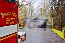 Flames were venting through the roof of this garage on Lawrence Avenue in Berwick shortly before 4 p.m. on May 6. – Adrian Johnstone