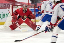 File photo/ Montreal Canadiens right wing Michael Frolik (67) shoots on Ottawa Senators goalie Filip Gustavsson (32) in the first period at the Canadian Tire Centre.