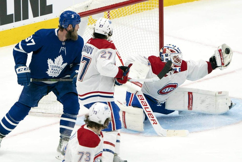 Canadiens goaltender Jake Allen make a nice glove save during the third period against the Leafs at Scotiabank Arena in Toronto.