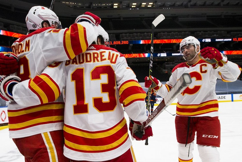 Calgary Flames Johnny Gaudreau (13) celebrates his goal with teammates during second period NHL action against the Edmonton Oilers on Saturday, May 1, 2021 in Edmonton. Greg Southam-Postmedia