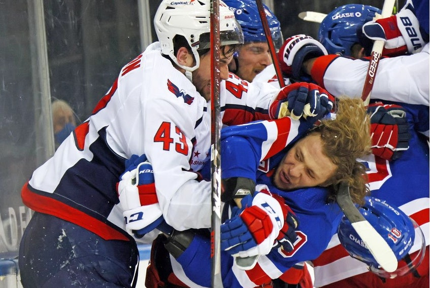 Tom Wilson, left, of the Washington Capitals battles Artemi Panarin of the New York Rangers at Madison Square Garden in New York on May 3, 2021.