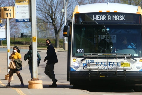 Halifax Transit passengers disembark from a bus at the Bridge Terminal in Dartmouth on Monday, May 3, 2021.