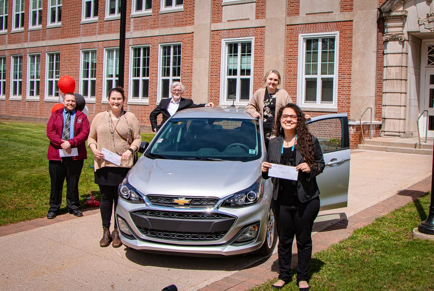 Holland College nursing student Jody Rethy earned a new 2021 Chevrolet Spark for her high grades this year. Four other students received $1,000. Shown, starting from left: Shawn Fraser, Laura Mills, Holland College president Alexander MacDonald, Jodi Rethy and Barbara Kalil. Missing from the photo is finalist Jill Kendall, and donor Lou MacEachern, who joined the event virtually.
