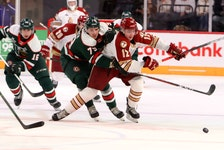 Enfield's Riley Kidney of the Bathurst Titan tries to break away from Halifax Mooseheads defenceman Jason Horvath during a Nov. 20, 2020 QMJHL game at the Scotiabank Centre. - Eric Wynne