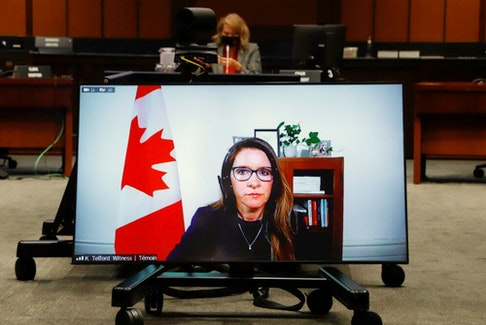 Katie Telford, Chief of Staff to Canada's Prime Minister Justin Trudeau, appears on a screen as she attends a House of Commons defence committee meeting on sexual misconduct in the armed forces, in Ottawa, Ontario, Canada May 7, 2021.