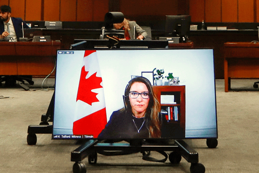 Katie Telford, Chief of Staff to Prime Minister Justin Trudeau, appears on a screen as she testifies at a House of Commons defence committee meeting on sexual misconduct in the Canadian Forces, in Ottawa, May 7, 2021.