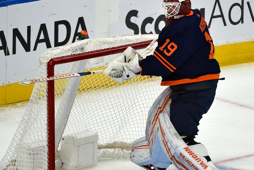 Edmonton Oilers goalie Mikko Koskinen (19) breaks his stick after allowing the fourth goal in under 13 minutes of play against the Vancouver Canucks at Rogers Place on May 6, 2021. He was taken out of the game after this.