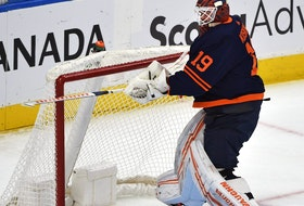 Edmonton Oilers goalie Mikko Koskinen (19) breaking his stick after allowing the fourth goal in four shots against the Vancouver Canucks during NHL action at Rogers Place in Edmonton, May 6, 2021.
