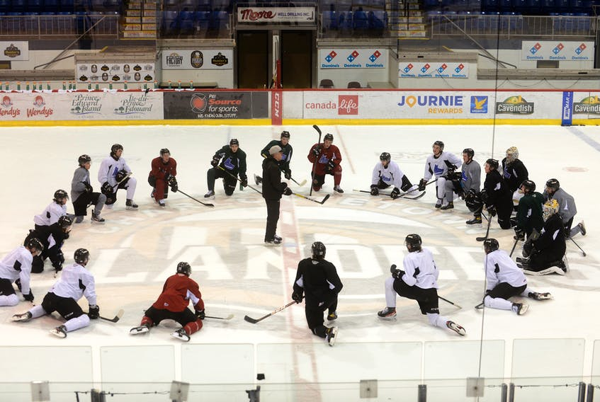 Head coach Jim Hulton, centre, addresses his Charlottetown Islanders on the Eastlink Centre ice for the final time on Wednesday. The team is in Shawinigan, Que., where they will play Game 1 of the Quebec Major Junior Hockey League's Maritimes Division final tonight.