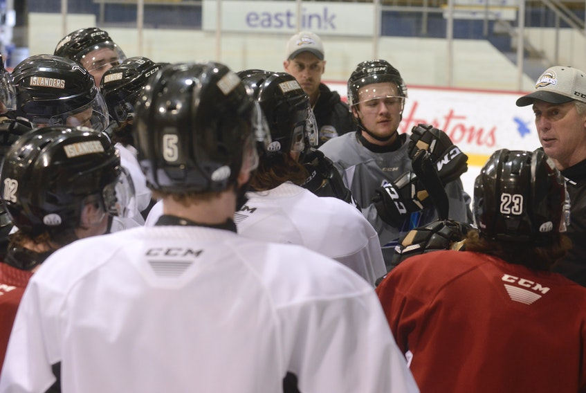 Charlottetown Islanders listen to head coach Jim Hulton, right, at Wednesday's practice at the Eastlink Centre.