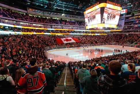 Hockey fans sing O Canada before the Edmonton Oilers play the Minnesota Wild at Rogers Place in Edmonton on Feb. 21, 2020.