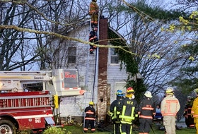 Firefighters battled a stubborn fire that started in a chimney in this Lockhartville home May 8.