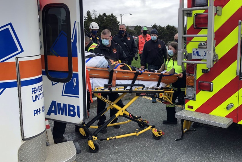 An injured hiker is placed aboard an ambulance at Topsail Beach Saturday afternoon. Joe Gibbons/The Telegram