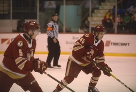 Acadie-Bathurst Titan defencemen Cole Larkin, left, and Zach Biggar during the 2019-20 Quebec Major Junior Hockey League season at the Eastlink Centre.