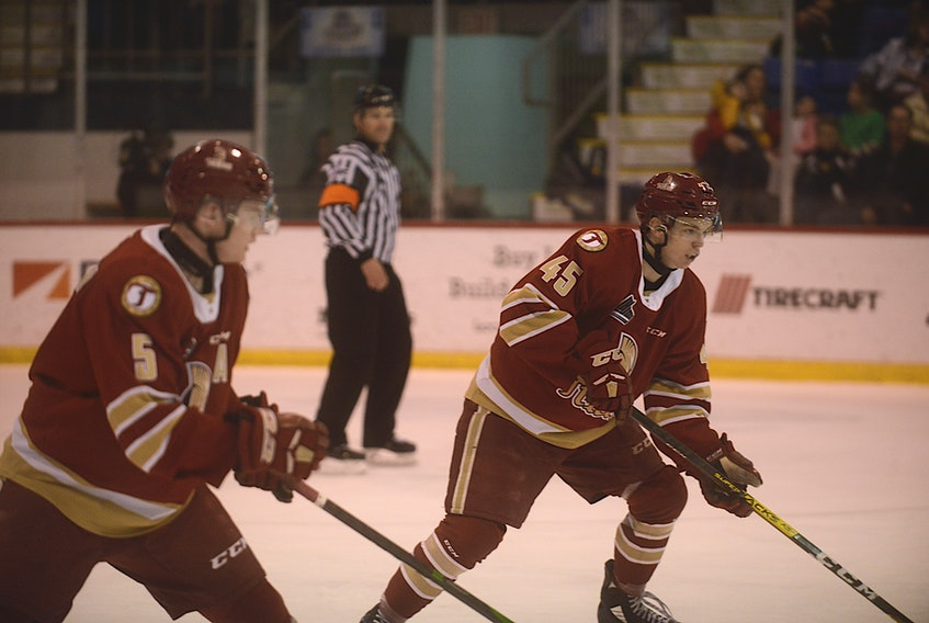 Acadie-Bathurst Titan defencemen Cole Larkin, left, and Zach Biggar during the 2019-20 Quebec Major Junior Hockey League season at the Eastlink Centre.