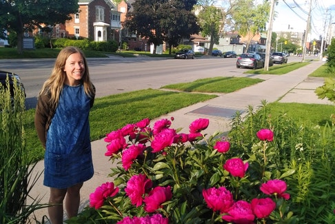 Sam Cullen enjoys the beauty of peonies. They are fragrant, showy and they cut well for use indoors.