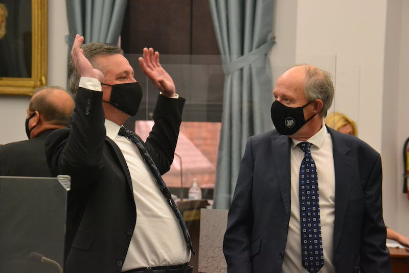Liberal MLA Heath MacDonald and Health Minister Ernie Hudson joke before a legislature sitting on Friday. MacDonald surprised Hudson, tabling a memo showing that surgeries from the PCH have been deferred to Charlottetown over a four-day period.  - Stu Neatby • The Guardian