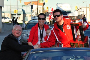 Ryan Pembroke Mayor Ed Jacyno greets Sheldon Keefe, his wife, Jackie, and their son, Landon, during a parade to celebrate the Lumber Kings' 2011 RBC Cup championship victory.
