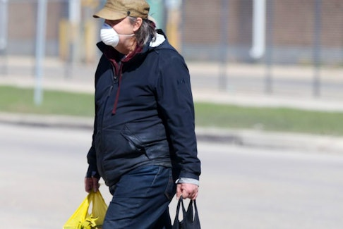 A person wears a mask in public, in Winnipeg on Friday, May 7, 2021.