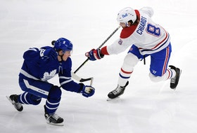 Maple Leafs forward Mitch Marner (left) blocks a shot by Montreal Canadiens defenceman Ben Chiarot on Saturday at Scotiabank Arena. Team defence has helped propel Toronto to the North Division title.