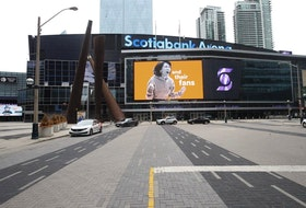 "An advertisement on the big screen at the Scotiabank Arena shouts ""For the fans."" COVID restrictions ensured Maple Leaf Square was a ghost town on May 9, 2021."