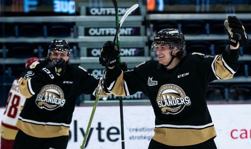 Charlottetown Islanders defenceman Oscar Plandowski, right, celebrates after scoring his first Quebec Major Junior Hockey League playoff goal Sunday in Shawinigan, Que., against the Acadie-Bathurst Titan. – Olivier Croteau - QMJHL