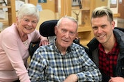 April O'Friel and her husband Jim O'Friel and grandson Andrew Allen, a singer, after Andrew had just finished performing some Christmas songs for all residents in December 2019 at Dufferin Care Centre. Jim later transferred to Eagle Ridge Manor in Port Moody.