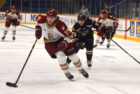 Cheticamp's Lane Hinkey, left, and the Acadie-Bathurst Titan are currently playing the Charlottetown Islanders in the Quebec Major Junior Hockey League Maritime Division. The Titan advanced to the division final winning the New Brunswick playoff round robin last week. JEREMY FRASER/CAPE BRETON POST