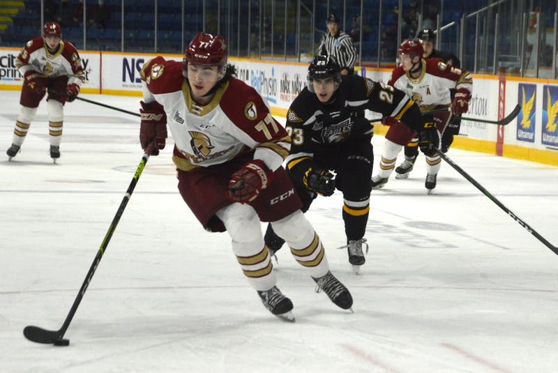 Cheticamp's Lane Hinkey, left, and the Acadie-Bathurst Titan are currently playing the Charlottetown Islanders in the Quebec Major Junior Hockey League Maritime Division. The Titan advanced to the division final winning the New Brunswick playoff round robin last week. JEREMY FRASER/CAPE BRETON POST - Jeremy Fraser