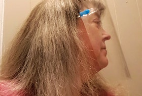 Joy Auld wears the face shield she's been using since the beginning of the pandemic.