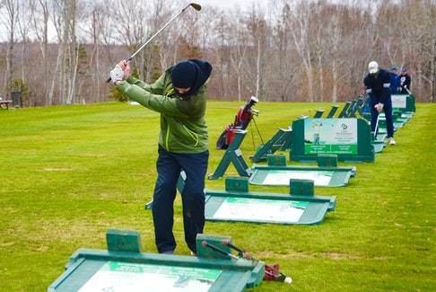 Almost unrecognizable without his pads, mask and stick, well-known local goaltender Jack Cashen already appears to be in mid-season form as he hits some balls at the driving range of the Lingan Golf Club. The 18-year-old New Waterford native, who spent the past two seasons with the Sydney Mitsubishi Rush of the Nova Scotia U18 Hockey League and was drafted by the QMJHL's Cape Breton Eagles, has a summer job at Lingan. Cashen said the course is in great shape and he's looking forward to some better weather. DAVID JALA/CAPE BRETON POST