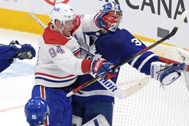 Maple Leafs goalie Jack Campbell holds the puck in his glove as he is hit by Canadiens forward Corey Perry in the first period at Scotiabank Arena in Toronto on Saturday, May 8, 2021.