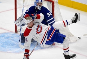 Canadiens forward Joel Edmundson loses his balance in front of Maple Leafs goalie Jack Campbell in the first period at Scotiabank Arena in Toronto on Saturday, May 8, 2021.