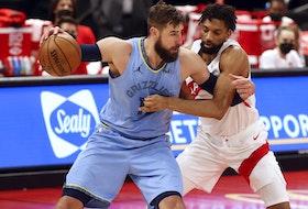 Memphis Grizzlies centre Jonas Valanciunas drives to the basket against Toronto Raptors centre Khem Birch on Saturday.