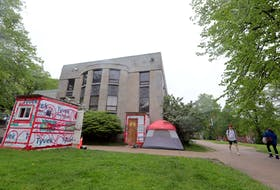 Photo of tents and temporary structures in front of the old Halifax Memorial Library on Spring Garden Road. To go with homelessness housing strategy stories.